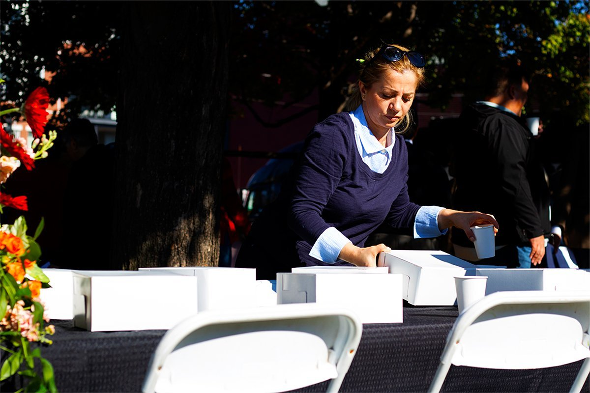 woman picking food boxes from table