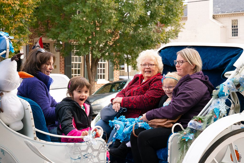 after visting the italian station for gelato, carriage riders enjoy a quick trip around downtown fredericksburg.