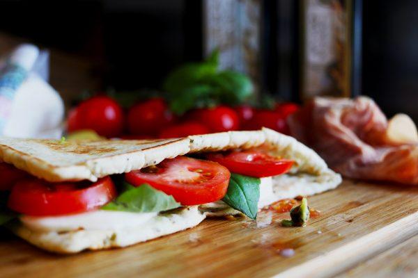 a freshly made caprese piadina with fresh tomato and mozzarella