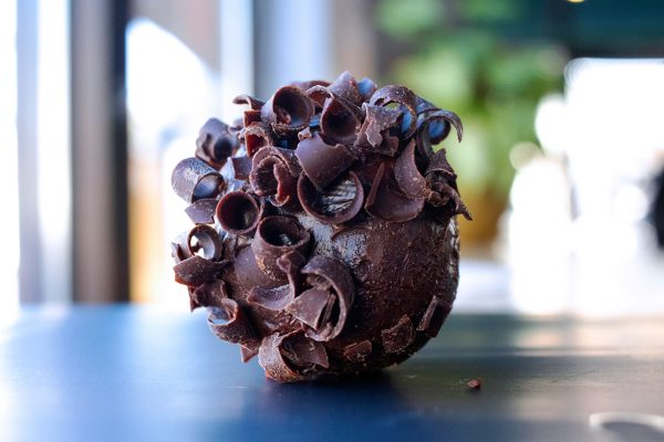 a chocolate truffle topped with bits of chocolate crunch