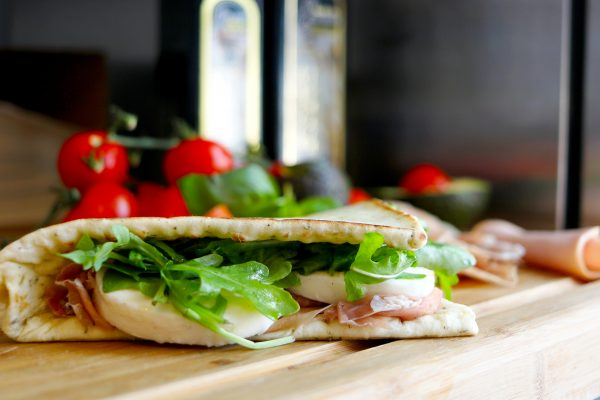fresh prosciutto and mozzarella on an italian flatbread sandwich
