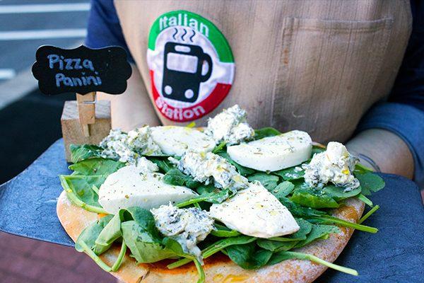 spinach and artichoke pizza on the corner of caroline street