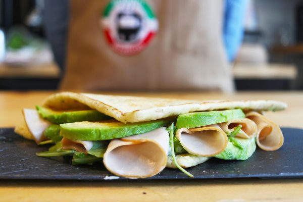 a turkey piadina with slices of avocado